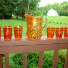Marigold Carnival Glass Northwood Grape and Cable Pitcher and tumblers