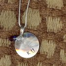 Medium Sterling Silver Circle Hand-Stamped Necklace