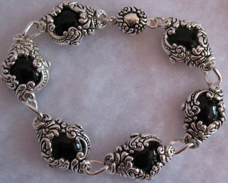 Bracelet with Black beads in ornate setting Jewelry CafeBug Women's Accessories