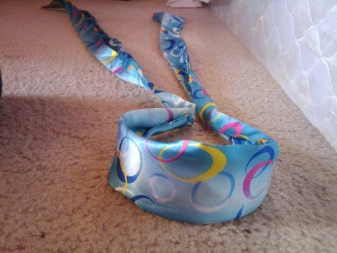 Blue headband with colorful swirls