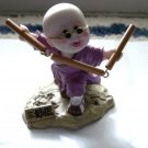 Little Asian Boy Practicing Martial Arts Figurine #300166