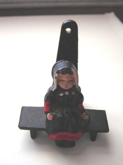 Cast Iron Egg Timer Amish Lady Sitting on Bench #300206