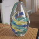 Clear Glass Egg Shaped Green Blue Yellow Swirls Paperweight at Periwinkles #301110