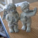 Two Small Naked Gray Angels Holding Harp and Stars #301732