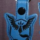 Team mystic blue keychain fob.