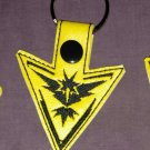 Team instinct yellow keychain