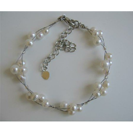 TB601  Freshwater Pearls Off White Pearls 3 Stranded Wire Bracelet
