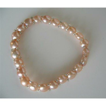UBR064  Peach Freshwater Pearls Stretchable Bracelet