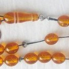 GREEK KOMBOLOI GOLD SPECKLED AMBER OVAL BEADS +STERLING
