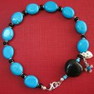 CATHOLIC ROSARY BRACELET IN TURQUOISE, ONYX & STERLING SILVER