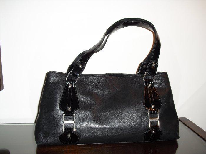 Black leather satchel handbag with patent leather