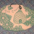 Bee Chasing Pottery Plaque