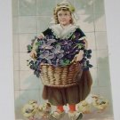 """Vintage Postcard """"A Happy Eastertide""""  Girl Carrying Basket Flowers W/ Chicks"""