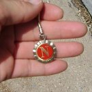 Husker Medallion for a key chain