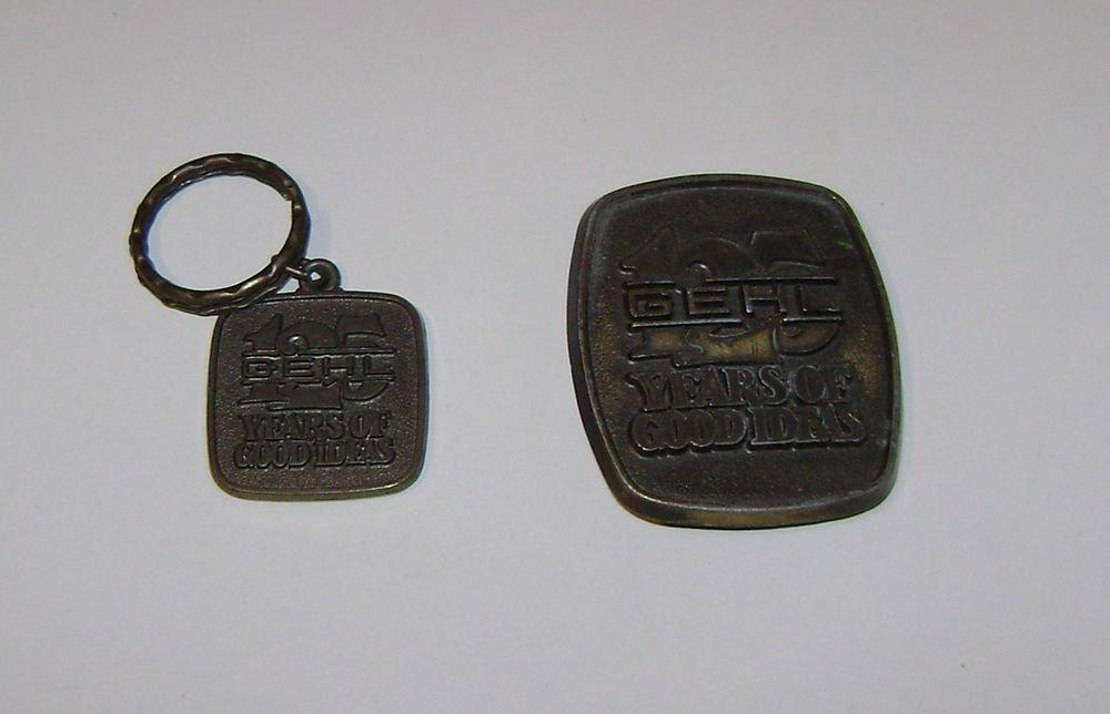 "Gehl Equipment ""125 Years"" Belt Buckle & Key Chain"