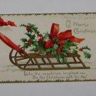 """Vintage Postcard """" A Merry Christmas"""" Misletoe on Sled"""