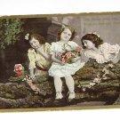 Vintage Postcard Three little Girls & Flowers