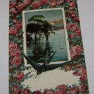 Vintage Postcard Roses Sun Setting Over Water & Bird Carrying Letter