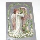 Vintage Postcard Easter Greetings  Angel Putting Flowers on Rock Cross