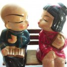 Early Vintage Oriental Kissing Boy Girl on Bench Salt Pepper 6318