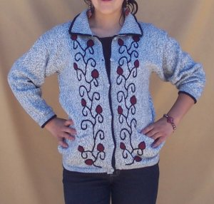 Lot of 10 alpaca sweaters adorned with flowers and leaves