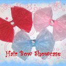 A Collection of Three Organza Hello Kitty Baby Bows