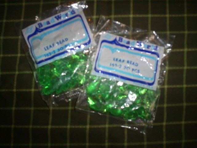 New,  Two packages of leaf beads,  30 pieces in each bag