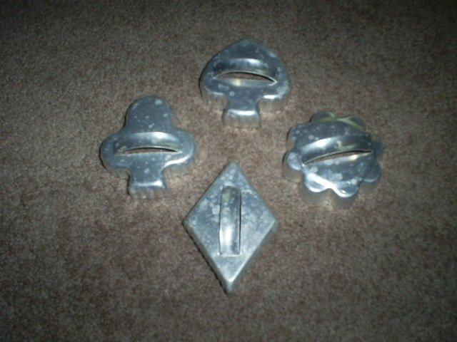 Four Vintage Metal Cookie Cutters