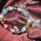 Beaded and Silver Charm Bracelet - Crosses