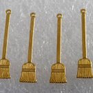 Vintage Set of 4 Brass Broom Sweeping STamping Pendant  Jewelry Making