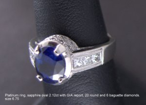 Blue Sapphire oval-cut 2.12cts., diamond and platinum ring