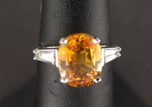 Orange Sapphire, weighing 4.16cts., in Platinum Ring