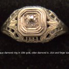 Antique diamond ring in 18kt gold, older diamond is .16ct