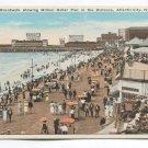 Boardwalk showing Million Dollar Pier in the Distance Atlantic City New Jersey Postcard