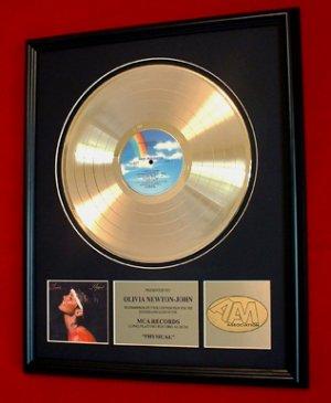 "OLIVIA NEWTON-JOHN GOLD RECORD AWARD ""PHYSICAL"""