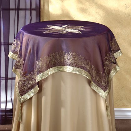 Purple Fabric Tablecloth With Gold Trim and Tassles.