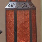 Tall Moroccan-Style Candle Lantern With Amber Glass Panels.