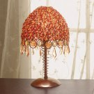 Metal Lamp With Orange and Red Beaded Lamp Shade.