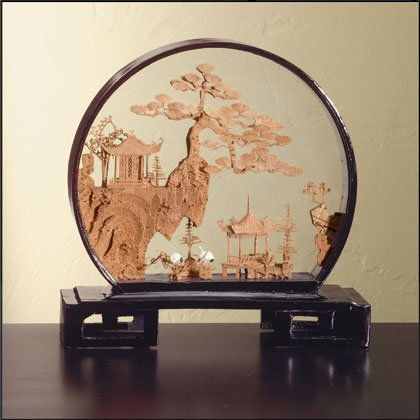 Cork sculpture with round black lacquer frame