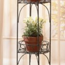 Antique two-tier metal planter shelf with verdigris finish