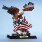 Eagle with American flag, on snow covered ledge.