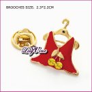 Lady Skirt Brooch, Brooches
