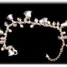 Lovely Avon Silvertone Bell & Clear Glass Bracelet