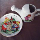 """Joan Walsh Anglund 1986 Avon Plate 5"""" and A Ceramic Watering Can 1975"""