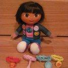 Fisher Price Dora the Explorer Sing Around the World Dora Doll with Bracelets