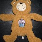 Kids II Tan Teddy Bear Sings Happy Birthday and its on the Cupcake on its tummy