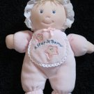 Kids 2 Grow Plush Pink Doll wearing a bib that says A Star is Born