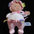 Taggies Mary Meyer Baby Pink Plush Doll with blue eyes and yellow curl