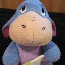 Plush Eeyore holding a blanket with a ladybug on it plush Rattle toy