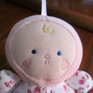 Kids Preferred  Plush Doll Rattle with heart cheeks and a flower on cordurory